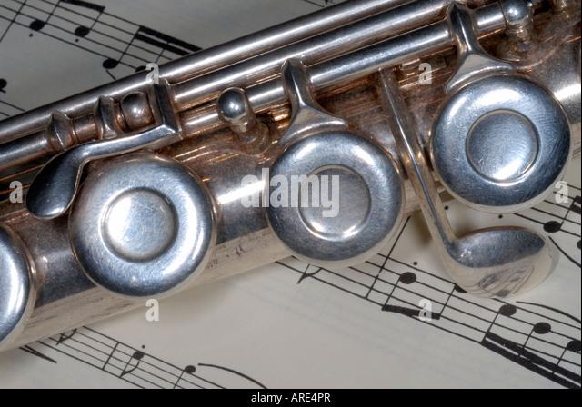 close up of a flute and sheet music - Stock-Bilder