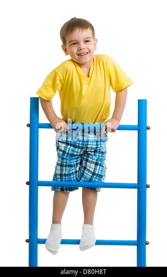 Happy kid boy on top of gymnastics ladder - Stock Image