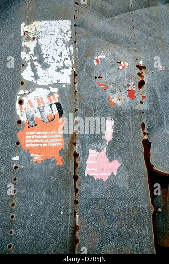 Remnants of an old Rabies warning poster on metal door, Baltimore, West Cork, Ireland - Stock Image