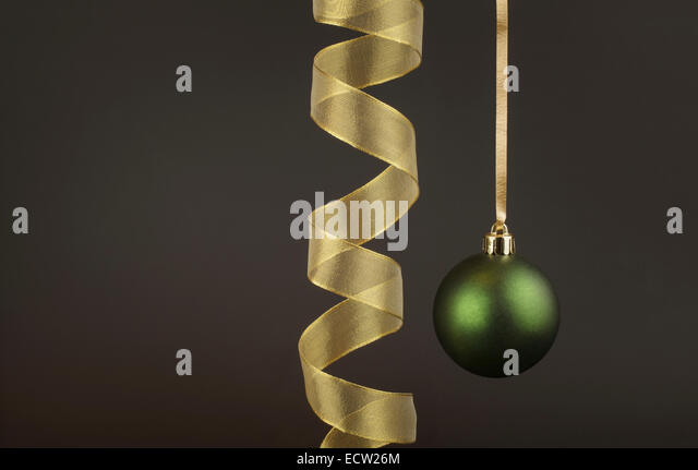Green Christmas Bauble with a gold Ribbon - Stock Image