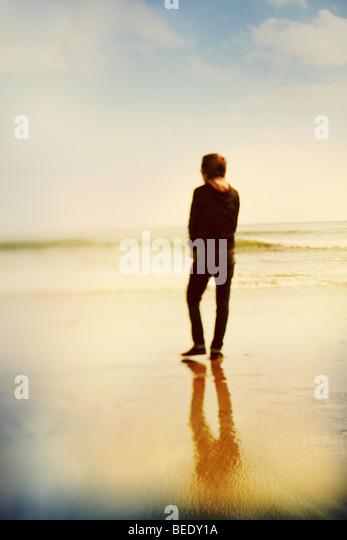 boy at waters edge - Stock-Bilder
