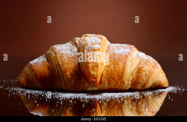 Fresh and tasty croissant with butter - Stock Image