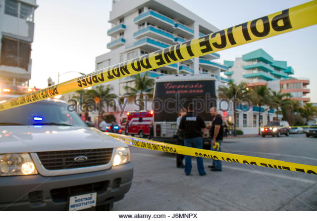Miami Beach Florida Ocean Drive accident bus bicycle rider collision police line do not cross tape - Stock Image