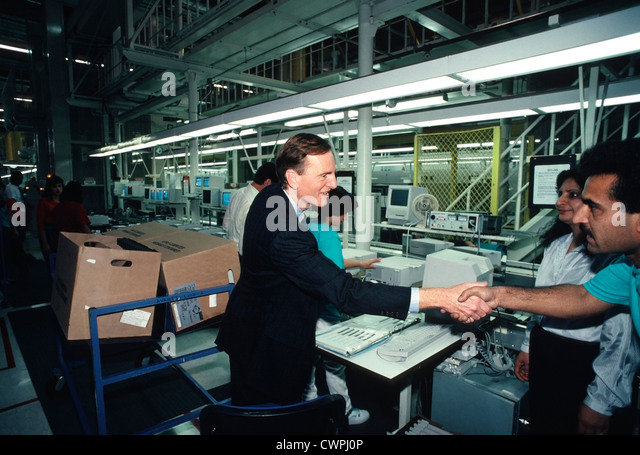 John Sculley, Apple CEO from 1983 until 1993, Shakes hands with Apple  employees at the Apple assembly Plant in - Stock Image