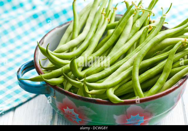 the green beans on kitchen table - Stock Image