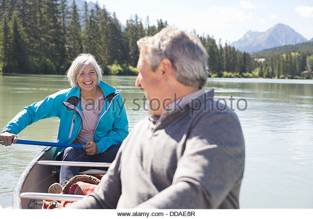Mature couple canoeing - Stock Image