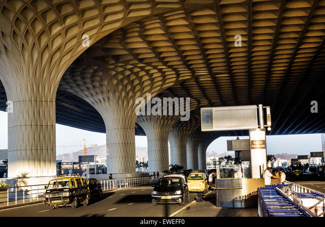 India Indian Asian Mumbai Chhatrapati Shivaji International Airport traffic columns design outside terminal architecture - Stock Image