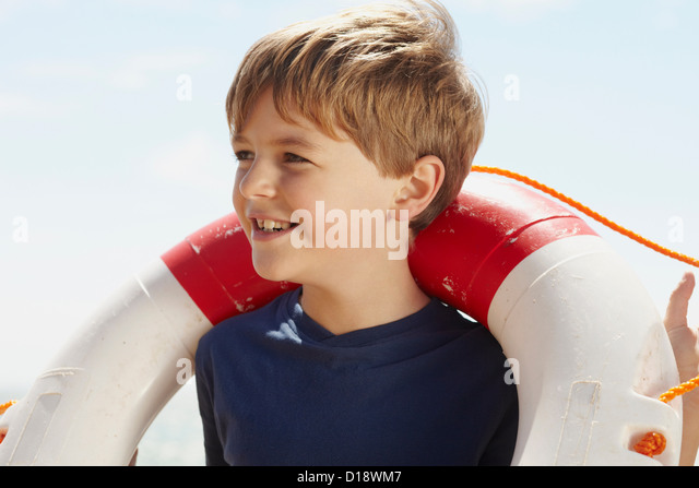 Boy with a life ring - Stock Image