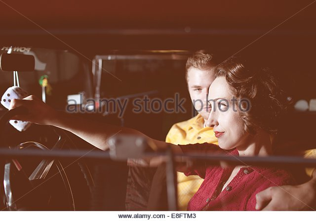 Young couple in vintage car - Stock-Bilder