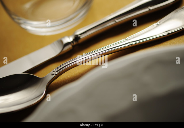 Elegant close up of a restaurant table, with a soft light - Stock Image