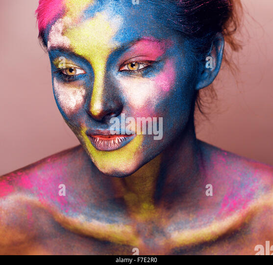beauty woman with creative make up like Holy celebration in India closeup - Stock Image