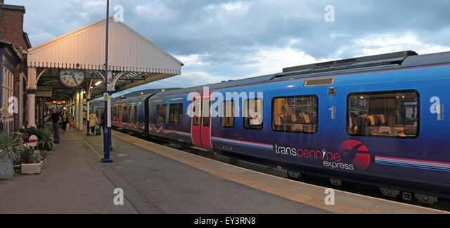 First Transpennine train at platform, Stalybridge Station at dusk, Greater Manchester, England, UK- Class 185 Desiro - Stock Image