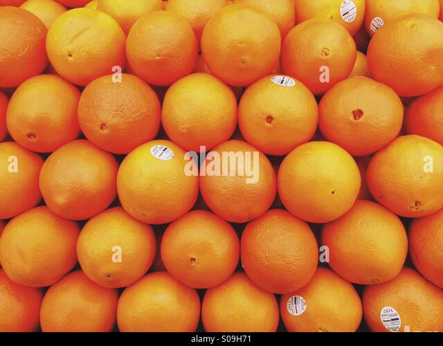 Wall of Oranges - Stock Image