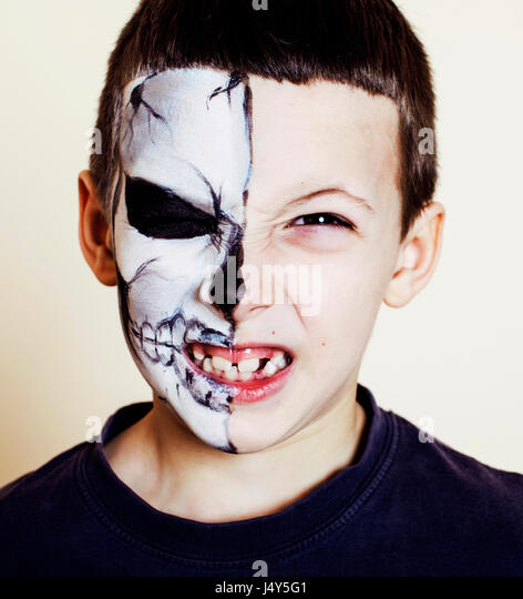 little cute boy with facepaint like skeleton to celebrate hallow - Stock Image