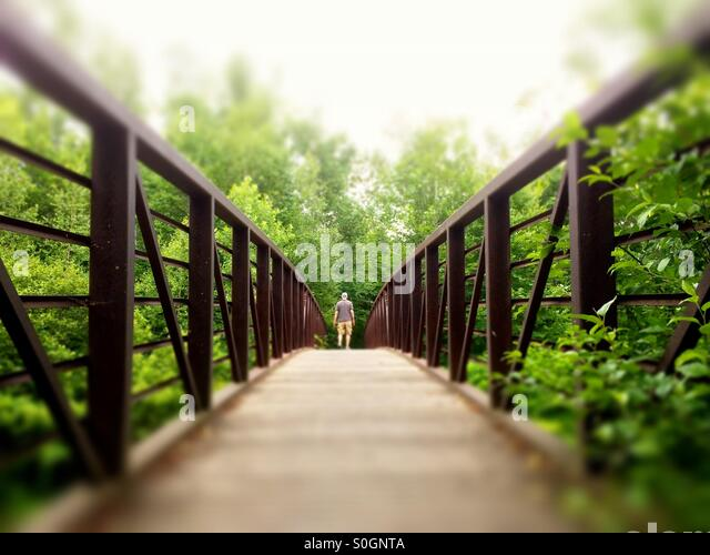 Man walking on Stowe Recreation Path, Stowe, Vermont - Stock Image