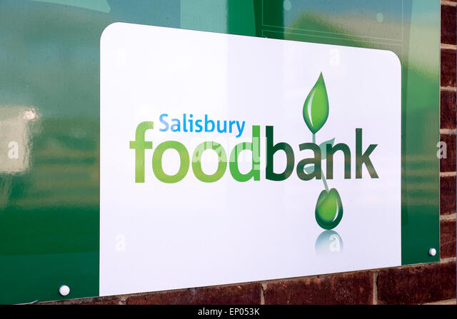 Charity food bank sign in Salisbury UK. Green text on white background - Stock Image