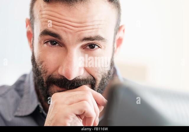 Portrait of mid-adult man - Stock Image