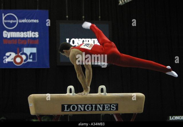 marius daniel urzica romanian gymnast on pommel horse - Stock Image