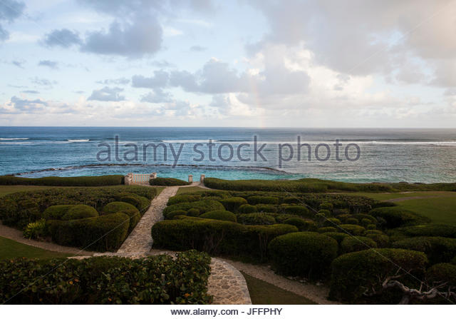 Path to the ocean from a garden in Punta Cana. - Stock Image