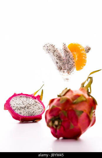 The slightly leafy rind and vibrant purple color of the pitaya is giving this exotic fruit its dragon-like appearance, - Stock Image