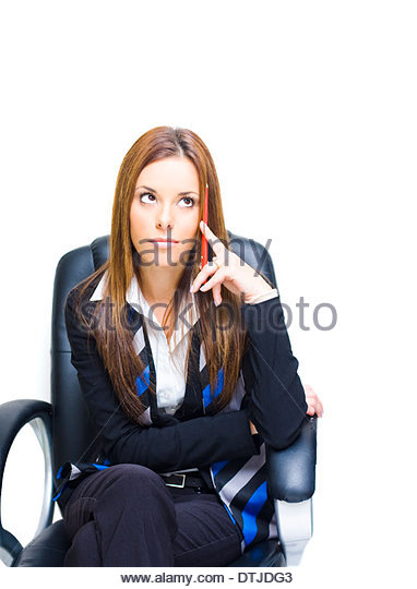 Thinking Business Woman Looking Up While Problem Solving With A Pencil In Hand In A Idea Image Representing Choices - Stock Image