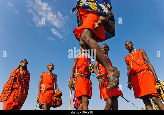 Masai tribespeople performing jumping dance, Masai Mara, Kenya - Stock Image