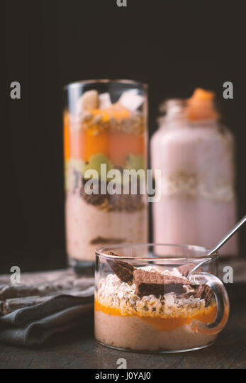 Smoothies pumpkin, avocado, blueberries on a black background vertical - Stock Image