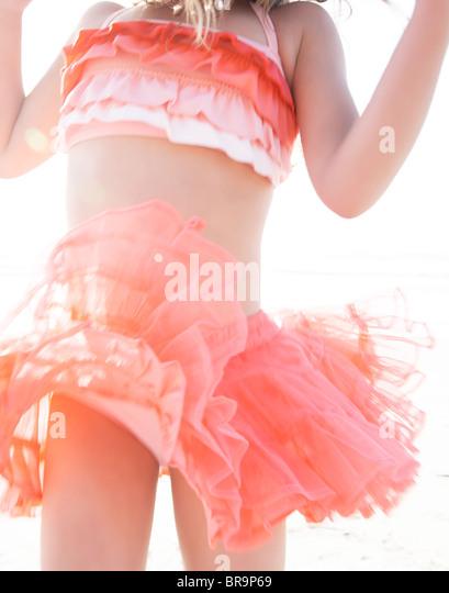 Young girl in bikini and tutu - Stock-Bilder