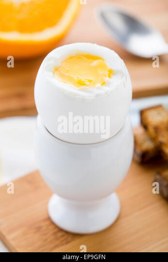 Breakfast with soft boiled eggs and  toast soldiers - Stock Image