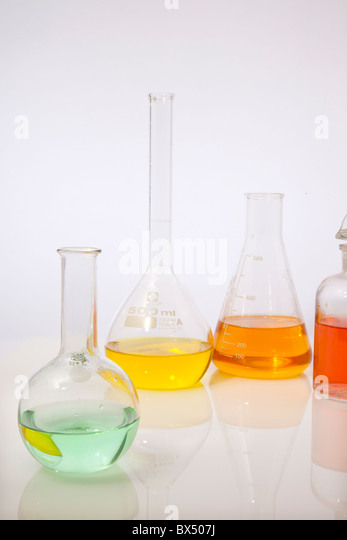 four chemistry flasks on white - Stock Image