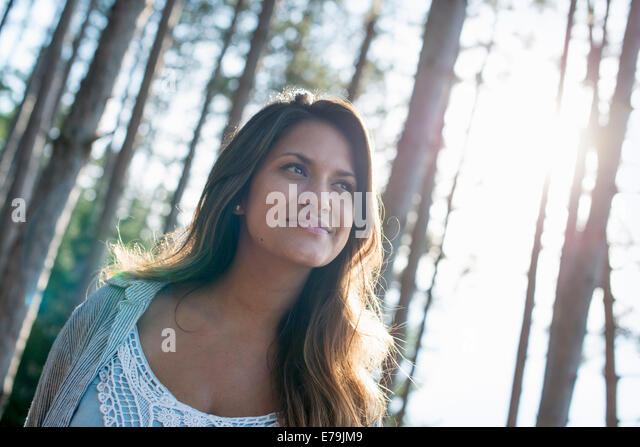 Portrait of a woman enjoying a leisurely walk in a forest. - Stock Image