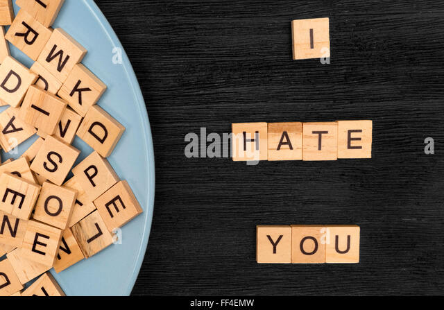 Wooden letters spelling I hate you - Stock Image