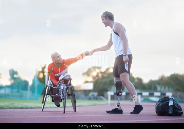Para-athletes doing fist bump - Stock-Bilder