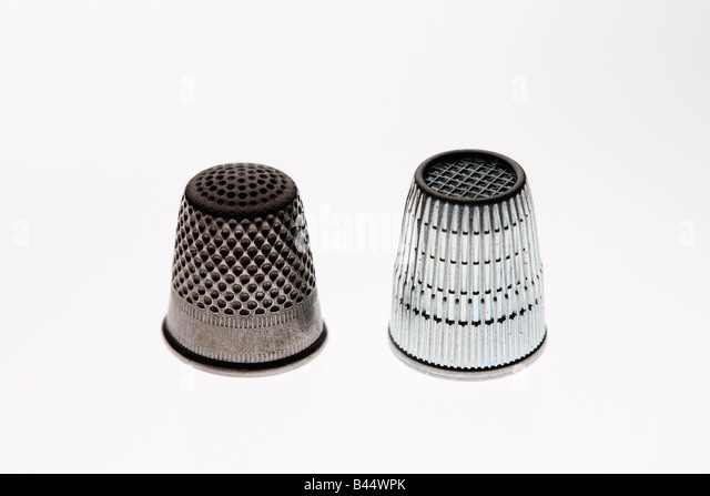 Old and new thimble side by side - Stock Image