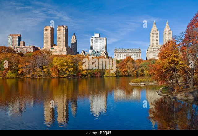 Skyline of Central Park West seen from the Lake in Central Park New York City. - Stock Image