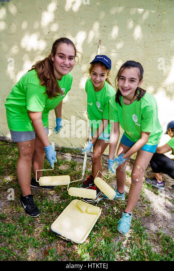 Miami Florida Allapattah Martin Luther King Jr. Day of Service MLK senior home repair Hispanic girl teen child corporate - Stock Image