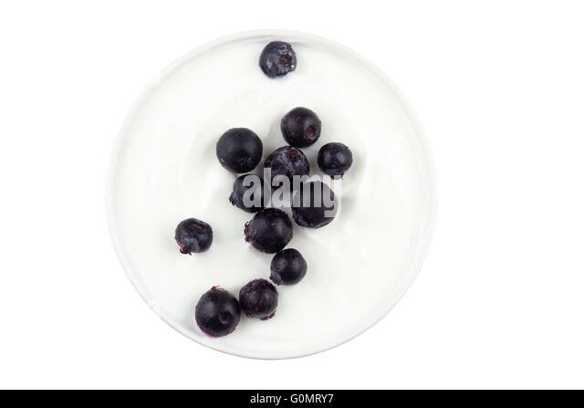 Saskatoon berries sprinkled on bowl of Greek yogurt - Stock Image