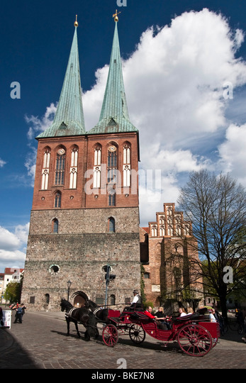 Carriage in front of Nikolaikriche, Nikolai church , Berlin, center, - Stock Image
