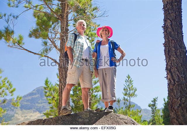 Portrait of senior couple on mountain path - Stock Image
