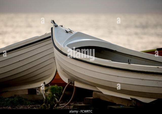 rowing boats stored on shore at an angling club in Hove, Sussex, UK - Stock Image
