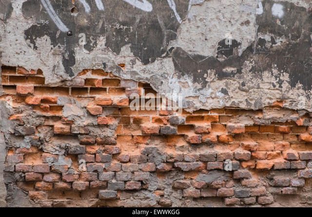 Badly decayed crumbling brickwork on a building wall. - Stock Image
