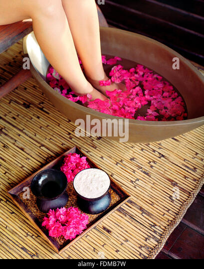 A woman gets a foot bath at the spa at The Farm at San Benito. Lipa City,Philippines. - Stock Image