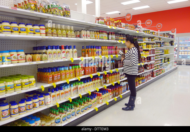 Woman choosing products at a supermarket in Toronto, Canada - Stock Image