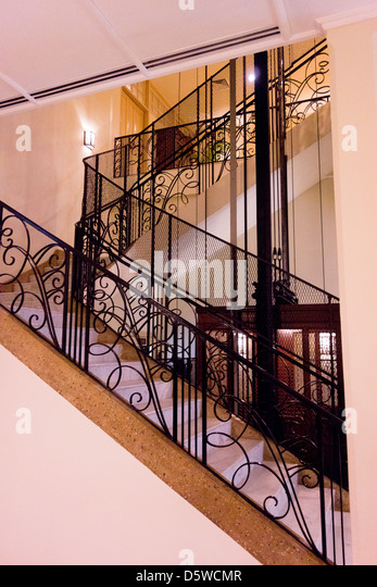 elevator and stairwell at historic Raffles Grand Hotel;Siem Reap; Cambodia - Stock Image