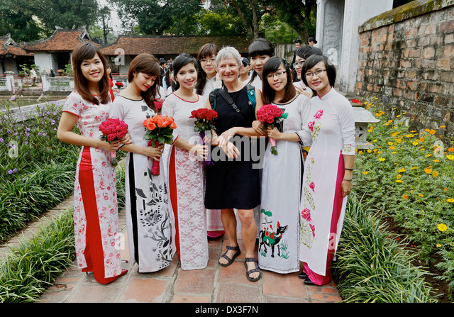 Students graduating from Vietnamese University celebrate at a ceremony held at the Temple of Literature Hanoi, Vietnam - Stock Image