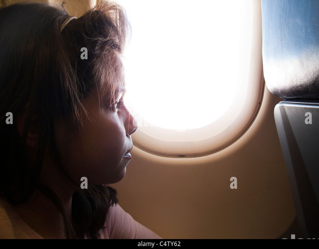 Girl ,9 years old,on an airplane - Stock Image