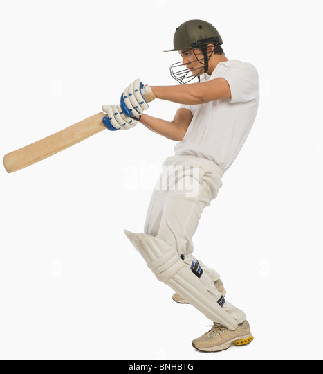 Cricket batsman playing a square cut shot - Stock Image