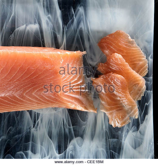 smoked salmon overhead plates - Stock Image
