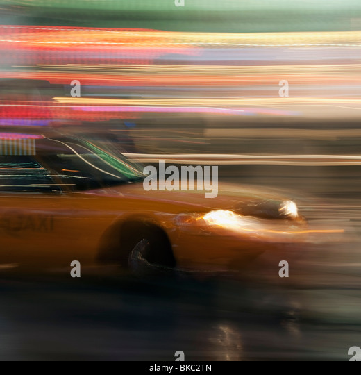 Yellow Taxi Traveling With Speed - Stock Image
