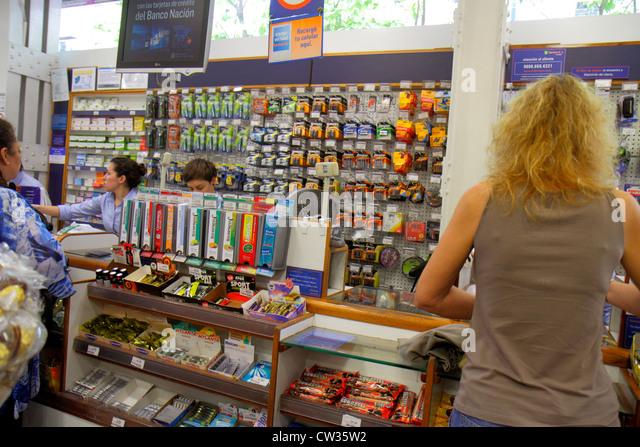 Argentina Buenos Aires Avenida de Mayo Farmacity chain drug store pharmacy retailer point-of-purchase impulse merchandise - Stock Image